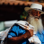 Man in White Hat with Sack, Carolina Del Principe thumbnail
