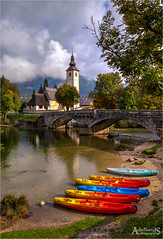 Bohinj Lake and Church (AdelheidS Photography) Tags: adelheidsphotography adelheidsmitt adelheidspictures slovenia church lake bohinj lakebohinj boats canoneos6d canonf4l2470mm bled bridge stonebridge vertical scenic pretty landscape water tree river sky cloud boat