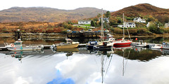 Colorful Kyleakin harbour on the Isle of Skye Scotland (Dave Russell (1.5 million views thanks)) Tags: reflecting colourfull color colourful colorful reflection reflections water sea ocean marine maritime boat boats vessel vessels vehicle vehicles transport sail sailing craft pontoon port harbour harbor mooring moorings alongside isle island skye inner hebrides west western scotland seascape landscape view vista scene scenery coast coastal mountain mountains travel tourism work workboat outdoor house houses building buildings