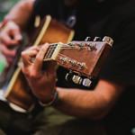 Young musician playing guitar thumbnail