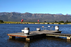 Lunch On The Lake (Элвин Ваутерсе) Tags: lunch lake restaurant table chairs breakfast dinner romantic skylinestudio elwinw nikon d3100 southafrica capetown africa afrikaans water mountain barrels flags view deserted empty scenery paarl za forest boat sky