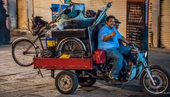2017 - Mexico - Guadalajara - Street Food Vendors (Ted's photos - For Me & You) Tags: 2017 cropped guadalajara mexico nikon nikond750 nikonfx tedmcgrath tedsphotos tedsphotosmexico vignetting guadalajaramexico guadalajarajalisco motorcycle bicycle bike wheels thumsup teeth dents gear ballcap streetscene street people peopleandpaths helmut wheel spokes cart fat males men riding riders pose posing