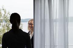on the balcony of a lake hotel (VisitLakeland) Tags: scandic hotel balcony women lake kuopio scene scenery lakeland finland hotelli huone room järvi järvinäköala parveke nainset curtains verhot