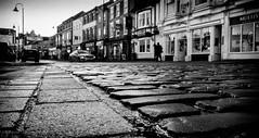 In the gutter (DWTait) Tags: beverley england unitedkingdom gb cobbles market street square monochrome