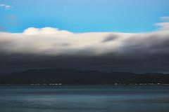 Clouds over mountains (Yuta Uch) Tags: exposure longexposure slow shutter clouds cloudscape sea ocean seashore seascape