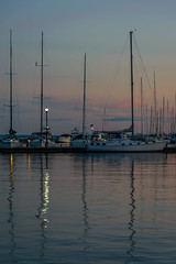 Natural light fading (FJMaiers) Tags: lamplight reflection marina sailboats dock bayfield wisconsin masts