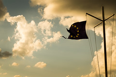The hard truth. (Manos Kour) Tags: sunset eu european union flag disaster clouds wind divided europe nowadays politics