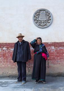 Tibetan couple in traditional clothing in Shachong monastery, Qinghai Province, Wayaotai, China