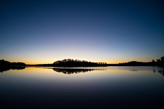 'I've got a peaceful, easy feeling ... ' (Canadapt) Tags: sunrise lake reflection island shoreline clear cloudless amber blue keefer canadapt