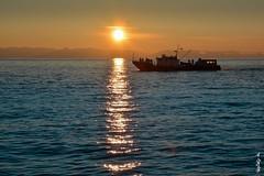 Baikal lake Sunset time... (N.Batkhurel) Tags: boat lake sunset sun water tourism travel season winter baikal russia ngc nikond5200 24120mm people