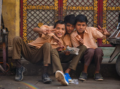 Indian boys sitting on street in Jodhpur, India (phuong.sg@gmail.com) Tags: asian bag beautiful bottle boy building campus cheerful child children classroom cute dirty education expression face facial happy india indian innocence innocent kid knowledge learn look looking male poor portrait poverty school sitting smile smiling street student three town uniform years young