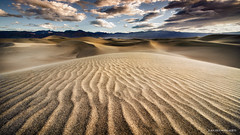 Death Valley sunrise (Jochen-B) Tags: deathvalleynationalpark usa america landscape sunrise light dunes heat clouds color lines sony a7rii alpha voigtlander 15mm wideangle sand california death valley shapes sun wind