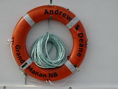 The Andrew and Deane Herring Carrier's life ring on Grand Manan Island (Bay of Fundy), New Brunswick (Ullysses) Tags: andrewanddeane herringcarrier grandmananisland bayoffundy newbrunswick canada summer été lifering northhead