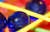 Kerplunk Marbles and Sticks 331/365 (Jacqueline138Kelly) Tags: jacquelinekelly nikon 105mm 365 365challenge 365the2017edition macro macromondays marbles sticks games toysandgames blue yellow closeup landscape reflections