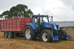 New Holland T7030 Tractor with a Smyth Grain Trailer (Shane Casey CK25) Tags: new holland t7030 tractor smyth grain trailer blue cnh nh castlelyons casenewholland newholland harvest grain2017 grain17 harvest2017 harvest17 corn2017 corn crop tillage crops cereal cereals golden straw dust chaff county cork ireland irish farm farmer farming agri agriculture contractor field ground soil earth work working horse power horsepower hp pull pulling cut cutting knife blade blades machine machinery collect collecting nikon d7100 tracteur traktori traktor trekker trator ciągnik