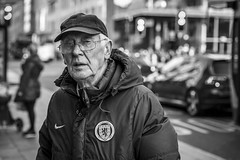 Est 1873 (Leanne Boulton) Tags: portrait urban street candid portraiture streetphotography candidstreetphotography candidportrait streetportrait eyecontact candideyecontact streetlife old elderly man male face facial expression eyes look emotion feeling mood cap tone texture detail depthoffield bokeh naturallight outdoor light shade shadow city scene human life living humanity society culture people canon canon5d 5dmkiii 70mm character ef2470mmf28liiusm black white blackwhite bw mono blackandwhite monochrome glasgow scotland uk