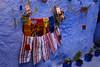handicraft Morocco_2010 (ichauvel) Tags: artisanat handicraft tabliers rayures murbleu bluewall rue street potsdefleurs flowers décoration chefchaouen chaouen chechaouen rif maroc morocco afriquedunord northafrica magreb exterieur outside getty