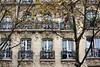 just a façade (overthemoon) Tags: france paris avenuedaumesnil architecture buildings façade 30 windows balconies trees people carvings heads elegant