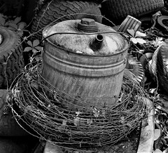 oil can (sharon'soutlook) Tags: oilcan blackandwhite bw wire junk trash scene tires