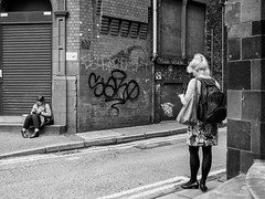 Northern Quarter 179 (Peter.Bartlett) Tags: manchester bag women window unitedkingdom city graffiti lunaphoto shutter girl monochrome uk m43 woman bw wall sitting people brick facade doorway drainpipe cellphone urbanarte doubleyellowlines urban steps niksilverefex olympuspenf noiretblanc microfourthirds mobilephone streetphotography standing corner blackandwhite peterbartlett candid