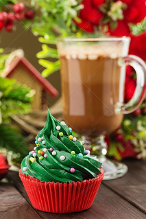 Green christmas cupcake in red cup