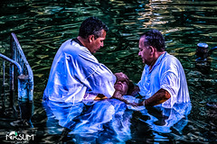 baptisimal in the jordan river (tchia sheffer) Tags: baptisimal white baptism robes sites with biblical significance prayers contemplation faith holy land spiritual religious art photography sacred christian new testament