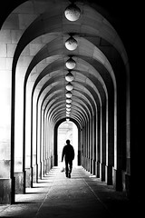 Enter into the Light (parenthesedemparenthese@yahoo.com) Tags: alone arcades bw backlighting enterintothelight man manchester nb noiretblanc royaumeuni silhouette street uk unitedkingdom blackandwhite blancoynegro bnw canoneos600d colonnes columns contrejour ef50mmf18ii hautcontraste highcontrast homme seul solmouillé wetfloor
