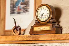Vintage wooden clock and a tobacco pipe on a stand on the mantelpiece (lika_ef) Tags: antique apartment artisanship background brown classic clock collect collectable craftsmanship cutout date decoration elegance estate fire fireplace flat grate historic history hour house interior luxury mantel mantelpiece marble nostalgia nostalgic object old one past pipe retro room seconds sherlock single smoke stone thing time timepiece tobacco vintage warm wood wooden