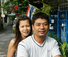 a couple on a motorcycle (the foreign photographer - ฝรั่งถ่) Tags: man woman couple motorcycle thai flags khlong thanon portraits bangkhen bangkok thailand canon