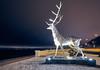Nov 25, 2017 (pavelkhurlapov) Tags: sunstars lampposts sculpture symbol river sky road night snow cityscape embarkment deer lights