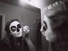 Joanne Putting on Her Sugar Skull Makeup (Mark Klotz) Tags: joanne makeup dayofthedead sugarskullmakeup paradeofthelostsouls pentax pentax645 filmphotography film mediumformat blackandwhite rollei rolleiretro400s blazinal rodinal iso400 smcpentaxa64545mmf28 markklotz