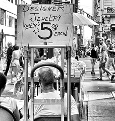Designer Jewelry (Demmer S) Tags: designer jewelry vendor retailer seller dealer sidewalk goods streetvendor display openair market shopping fashion merchandise accessories outside boxes outdoors boxed box street streetphotography people pedestrian peoplewatching shootthestreet streetlife streetshots documentary candid candidstreet citylife person urban city pedestrians ny newyork nyc newyorkcity bw monochrome blackwhite blackandwhite blackwhitephotos blackwhitephoto sign words text typography table