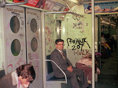 Mr Soul, Mini 125, Frank 207, Stitch 1, Lantern II, Sky 3  and even Hulk added the appropriate ambiance to the 1970s subway experience. That's my dad in a suit. Sis points to something between cars; perhaps a rat. March 1973. New York. (wavz13) Tags: newyorkphotographs newyorkphotos urbanphotography urbanphotos urbanscenes cityphotography urbanlife newyorklife manhattanlife oldsigns vintagesigns oldphotographs oldphotos 1970sphotographs 1970sphotos oldphotography 1970sphotography vintagesnapshots oldsnapshots oldnewyorkphotography oldnewyorkphotos vintagenewyork vintagemanhattan vintagenewyorkphotography vintagenewyorkphotographs vintagenewyorkphotos railroadphotos railroadphotography railroads vintagerailroads vintagerailroadphotography oldrailroads oldrailroadphotography cityphotos 110film kodacolor analogphotography filmphotography instamatic pocketinstamatic oldsubways vintagesubways 1970ssubways vintagekids vintageteens vintageteenagers manhattanhistory newyorkhistory manhattanskyline newyorkskyline newyorkskyscapers 1970smanhattan 1970snewyork oldnewyork oldmanhattan graffiti vintagegraffiti oldgraffiti 1970sgraffiti subwaygraffiti
