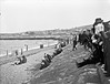 Down by the Sea (National Library of Ireland on The Commons) Tags: robertfrench williamlawrence lawrencecollection lawrencephotographicstudio thelawrencephotographcollection glassnegative nationallibraryofireland probablecataloguecorrection possiblecataloguecorrection crowd beach waterfront pier dayout wicklow countywicklow gasworks gasometer murragh northgroyne groyne bathingstrand murrough strand locationidentified regatta