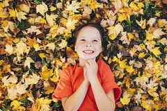 Golden girl (Elizabeth Sallee Bauer) Tags: autumn child childhood fall fun girl harvest kid leaves outdoors outside overhead playing warmth yellow