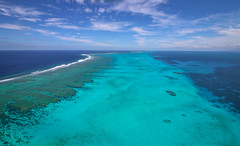 New Caledonia Reef (Andy.Gocher) Tags: andygocher canon100d canon1018mm windowseat aerial pacific coast coralsea bluesky blue green water aqua coralreef clouds sea