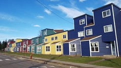 Row of colorful homes, Moncton, New Brunswick (Coastal Elite) Tags: moncton newbrunswick nouveaubrunswick new nouveau brunswick houses home architecture design residential street rue lewis maisons maison house colors colours colour color colourful colorful block blocks fenêtres windows square symmetrical symetry