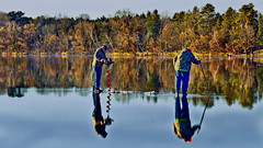 Why SKATE when you can FISH ?? (Bob's Digital Eye) Tags: 2017 bobsdigitaleye canon canonefs55250mmf456isstm fishing flicker flickr gasiceauger h2o ice lake lakeice lakeinwinter minnesota november reflections sport t3i laquintaessenza people trees