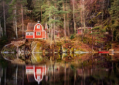 Curious (Birgitta Sjostedt) Tags: hose cottage summerhouse forest lake reflectionsfairytale water landscape