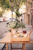 Spring streets (ninasclicks) Tags: flowers table street bokeh dof spring sidewalk