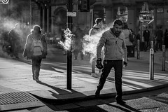 Vaper Trails (Leanne Boulton) Tags: people urban street candid portrait streetphotography candidstreetphotography streetlife backlit contrejour man male smoke smoker smoking vape vaper vapour vaping electroniccigarette face faces walking motion shape form tone texture detail clarity depth naturallight outdoor sunlight light shade shadow city scene human life living humanity society culture lifestyle canon canon5d 5dmkiii 70mm ef2470mmf28liiusm black white blackwhite bw mono blackandwhite monochrome glasgow scotland uk