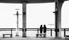 Best friends passing time - Hong Kong Ferry Terminal (Chas56) Tags: monochrome blackandwhite silhouette street hongkong highkey canon canon5dmkiii people ferryterminal travel streetphotography friends schoolfriends blackwhite contrast