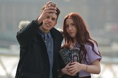 Lets take a Selfie (Stuart Mac) Tags: d7100 couple teens selfie faces smile portrait bokeh isolation southbank london candid