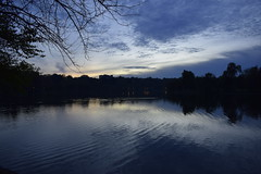 Blue (fdlscrmn) Tags: park water lake reflection cityscape clouds bucharest silhouettes bluehour blue sunset ciel nikkor naturaleza natural pond ripples