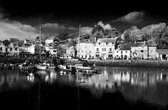 Padstow Harbour (Christian Hacker) Tags: padstow cornish cornwall northcoast coastal canon eos50d tamron 1750mm water reflections houses boat boats ship ships mast busy touristy tourism town blackandwhite mono monochrome clouds sunny buoy ripples rick stein