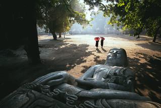 Forgotten buddha, Buddha statue laying on the ground, Mandalay Myanmar