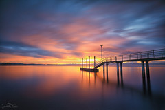 there's a calm before the storm (judith.kuhn) Tags: natur nature landscape seascape waterscape landschaft steg jetty sunrise sonnenaufgang wasser water bodensee lakeconstance himmel sky clouds wolken spiegelung reflection berge mountains alpen alps
