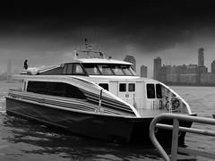 olY/310 .. the commuter! (m_laRs_k) Tags: 14150 suppenzoom omd bw olympus commuter 7dwf blackandwhite schwarzweis nyc manhattan nj usa travel bigapple empire state building skyscrapers skyline ship catamaran speedboat hudson river new jersey york ny 纽约 ньюйо́рк кора́бль 轮船 wolkenkratzer schiff pendler pendeln