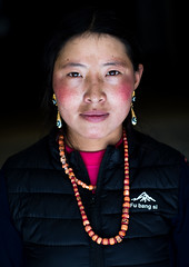 Portrait of a tibetan nomad woman with her cheeks reddened by the harsh weather, Qinghai province, Tsekhog, China (Eric Lafforgue) Tags: 2025years adorned amdo asia asian asianethnicity beautifulpeople china china17334 colourimage darkbackground ethnic ethnicity frontview headshot huangnan jewel jewellery jewlery lookingatcamera necklace nomad oneadultonly onepersononly onewomanonly ornament ornamental ornate ornated people portrait posing qinghaiprovince tibet tibetan tibetanautonomousprefecture tongren traditionalclothing travel tsekhog vertical women worldtravel zekog chn