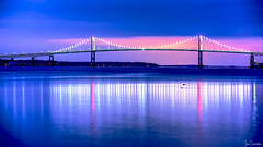 Pell Bridge at Blue Hour (Ian Charleton) Tags: bridge pellbridge calibournepellbridge newportbridge newport rhodeisland narragansettbay lighthouse roseisland roseislandlighthouse water bay sea seascape reflection longexposure architecture transportation sky
